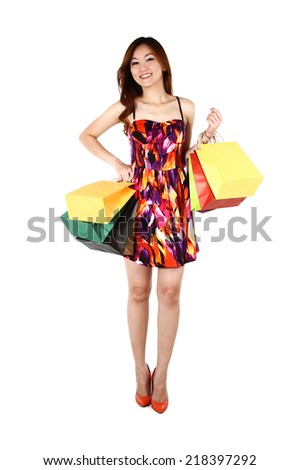 Asian woman with shopping bags, on a white background - stock photo