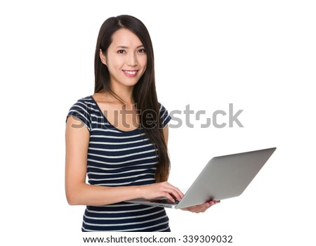 Asian Woman working with the notebook computer