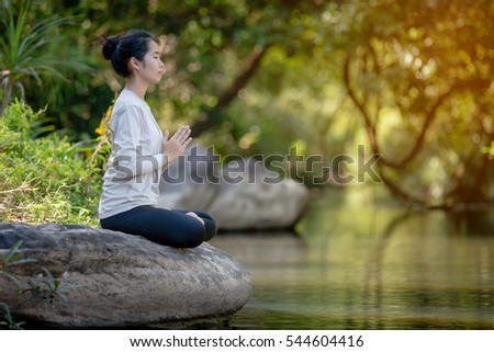 asian woman Yoga - relax in nature
