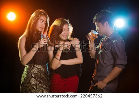 Asian women and men Drinking beer and having fun at a party
