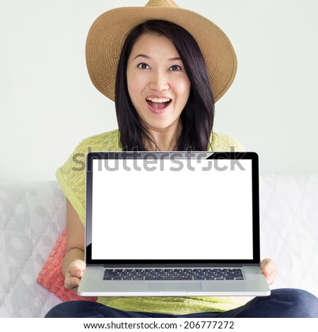 Asian women are cute and laptop, blank screen with clipping path.