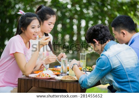 Asian women Are eating with friends Her dining Thaifood Happily