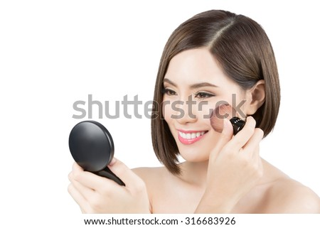 Asian women are make yourself her cheeks - stock photo