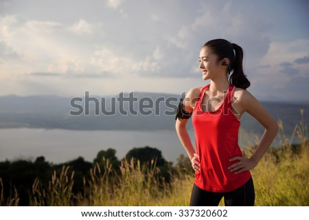 Asian women are relaxing out of the running exercise. She is looking sun - stock photo