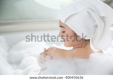 Asian women are shower in bathtub - stock photo