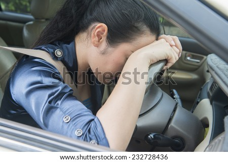 Asian women asleep while driving - stock photo