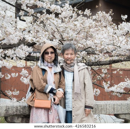 Asian women portrait - Senior mother and adult daughter looking to the camera at Nishikyo - ku, Kyoto, Japan - stock photo