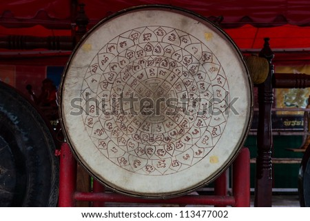 Asian wooden leather old temple drum with very old vintage talisman tattoo symbol on it - stock photo