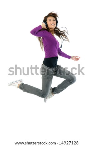 Asian young adult jumping in the air with - stock photo