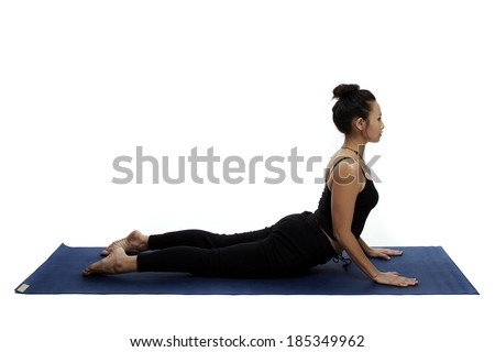 Asian young beautiful yoga posing on a white studio background.