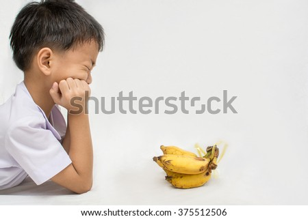 Asian young boy expression of disgust ,Concept dislike Banana