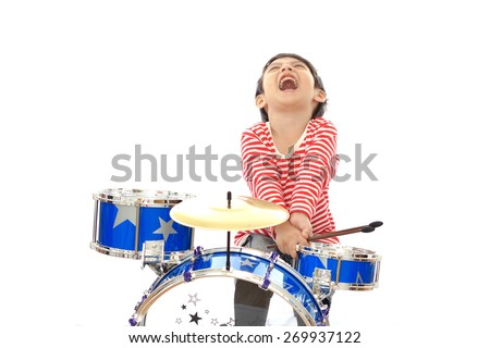 Asian young boy playing blue drum on white background - stock photo