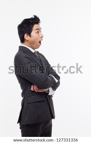 Asian young business man surprized isolated on white background. - stock photo