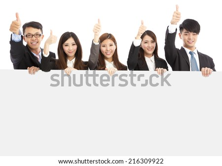 asian young business people holding white board and thumb up over white background - stock photo