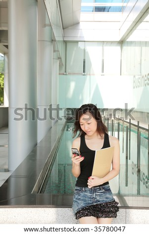 Asian Young Business Woman on the Phone - stock photo