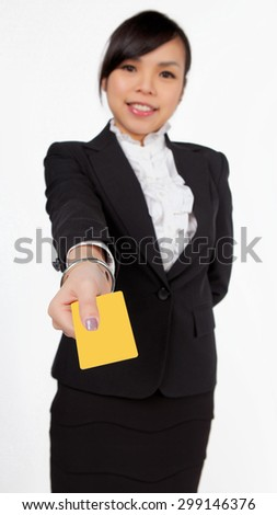 Asian young business woman with yellow card / sticker isolated on the white background. - stock photo