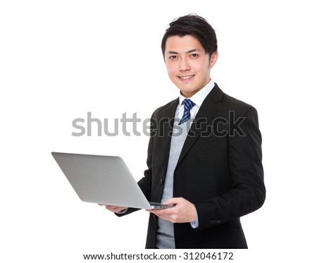 Asian young businessman use of the notebook computer