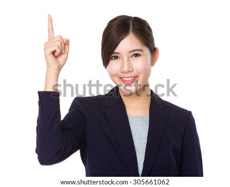 Asian young businesswoman finger point up - stock photo