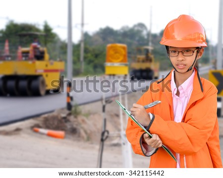 asian young engineer on construction site - stock photo