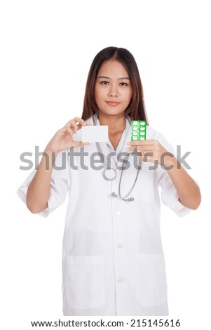 Asian young female doctor show a blank card with medicine  isolated on white background - stock photo