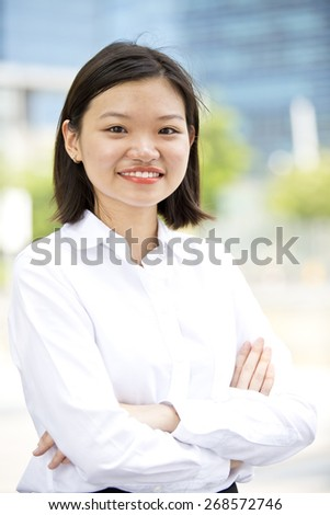 Asian young female executive smiling portrait - stock photo