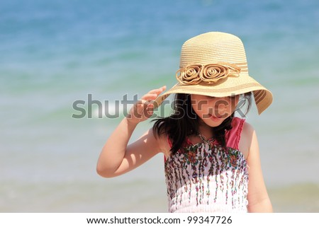 Asian young girl on the beach - stock photo