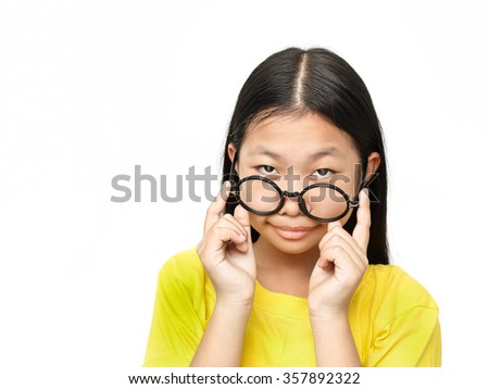 Asian young girl with glasses looks questioningly