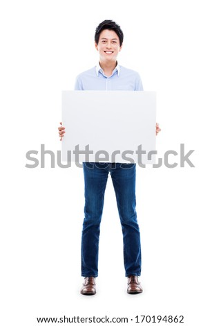 Asian young man showing pannel isolated on white background.  - stock photo