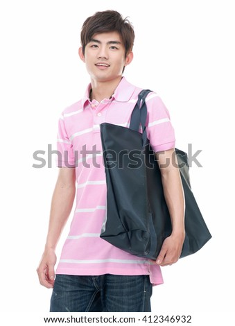 Asian young man standing man with bag - stock photo