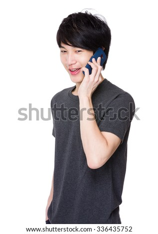 Asian Young man use of the mobile phone - stock photo
