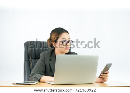 Asian young office workers are working to shake the phone to the laptop while working in the office ,With isolated white background, Business concept