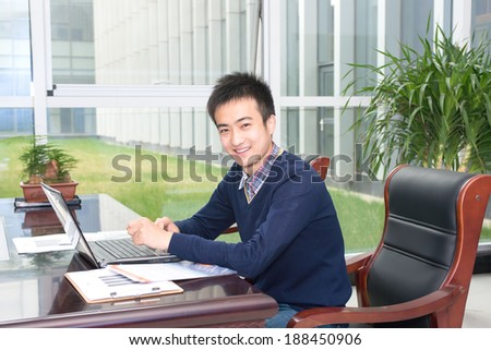 Asian young people in business training, smiling for the camera - stock photo