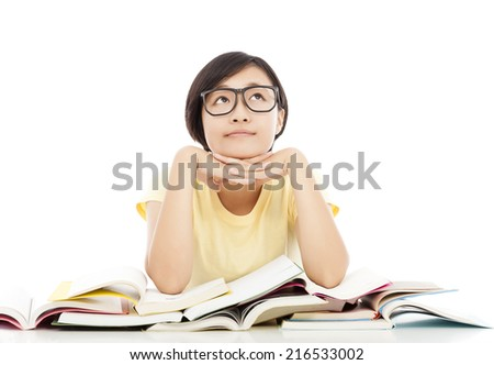 Asian young student girl thinking with book over white background - stock photo