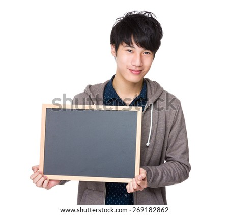 Asian young student show with blackboard - stock photo