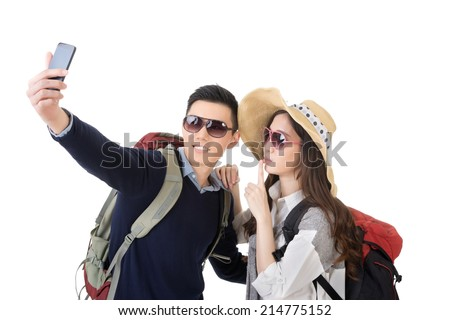 Asian young traveling couple selfie, full length portrait isolated on white background. - stock photo