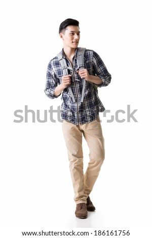 Asian young traveling man walking, full length portrait isolated on white. - stock photo