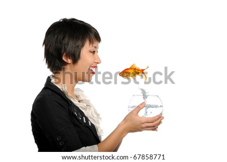 Asian Young Woman holding tank with gold fish jumping isolated on a white background - stock photo