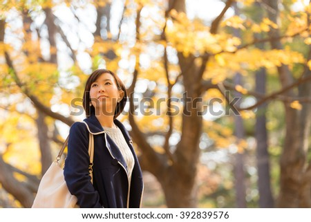 Asian young woman in Autumn forest. - stock photo