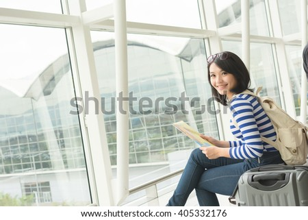 Asian young woman in the airport wait the aircraft - stock photo