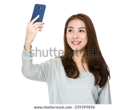 Asian Young Woman take the selfie - stock photo