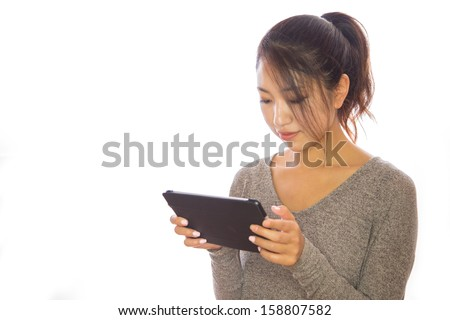 Asian young woman using tablet pc