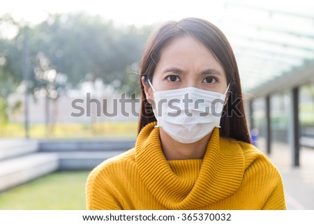 Asian Young woman wearing the face mask for protection - stock photo