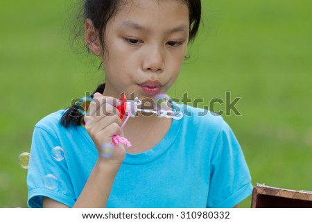 Asians girl blowing bubble outdoor