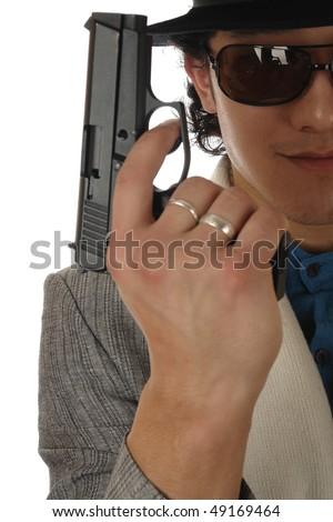 asin man in hat holding gun - stock photo