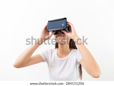 Asin woman two hand holding on VR devcie - stock photo
