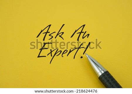 Ask An Expert! note with pen on yellow background