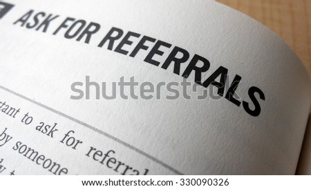 Ask for referrals word on a book. Business success concept