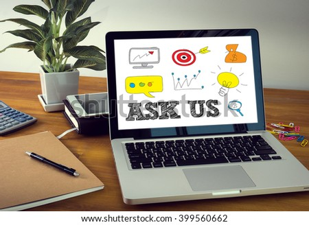 ASK US concept Laptop on table. Warm tone - stock photo