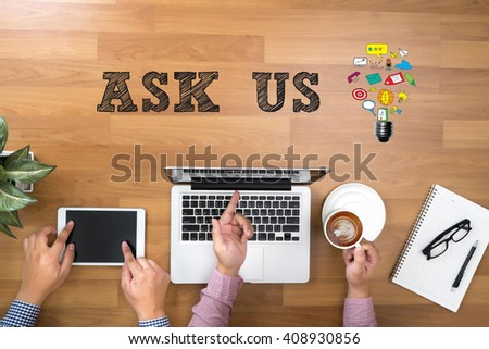 ASK US concept Two Businessman working at office desk and using a digital touch screen tablet and use computer objects on the right, top view copy space - stock photo