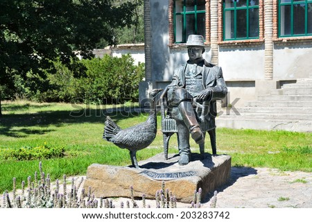 ASKANIA-NOVA, KHERSON REGION, UKRAINE - JULY 1, 2014: made by one's lifetime photo monument to Friedrich Falz Fein who founded Ukrainian worldwide famous Askania-Nova natural reserve. - stock photo